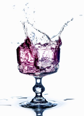 squirted: A purple drink splashing from a glass LANG_EVOIMAGES