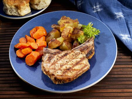 pork chop: Pork chop with carrots and fried potatoes LANG_EVOIMAGES