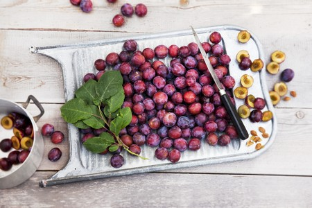washboard: Freshly harvested damsons on an old washboard on a wooden table LANG_EVOIMAGES