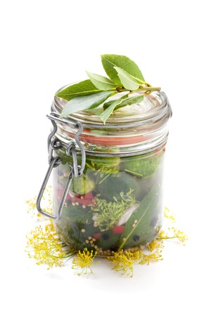 gherkins: A jar of homemade gherkins with dill flowers and bay leaves