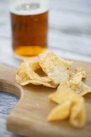 crisps: Crisps and a glass of beer