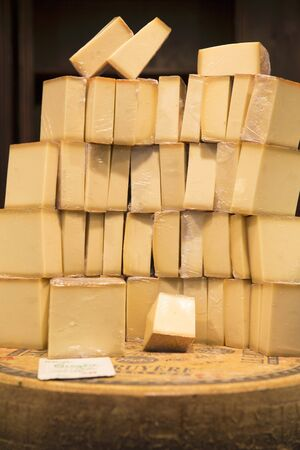 gruyere: A stack of Gruyere on a wheel of cheese