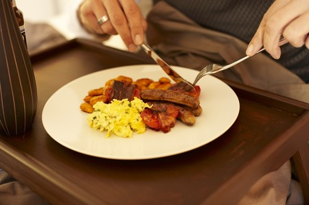 origin of man: An English breakfast with scrambled eggs, baked beans, tomatoes, bacon and sausages