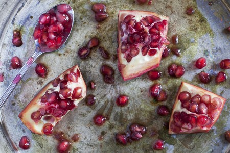 silver tray: Sliced pomegranate on a silver tray