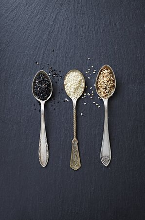 seeds of various: Various types of sesame seeds on three spoons