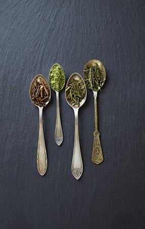 sencha tea: Various types of green tea on spoons