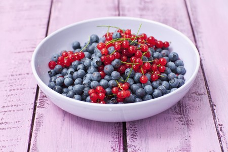 redness: A bowl of redcurrants and blueberries