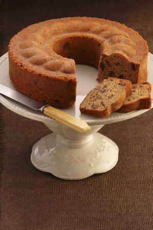 coffee cake: Date and coffee cake, sliced, on a cake stand