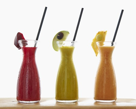 multivitamin: Three different smoothies in carafes