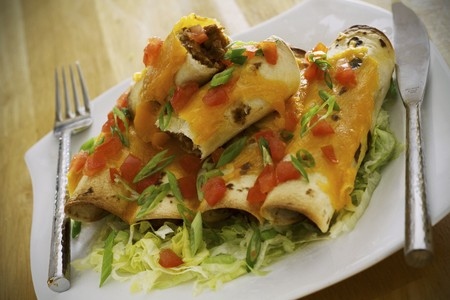 spring onions: Beef enchiladas with spring onions and tomatoes