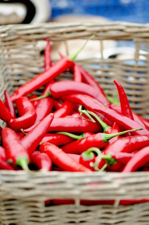 willow fruit basket: Fresh red chilli peppers in a wicker basket