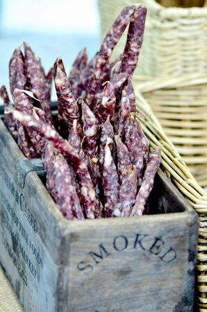hard sell: Mini salamis in a wooden crate at a market