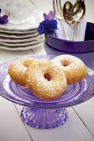 cakestand: Doughnuts on a glass purple cake stand