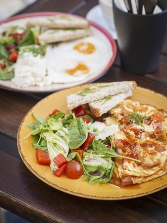 well made: A healthy breakfast featuring crêpes, salad, fried egg and toast LANG_EVOIMAGES