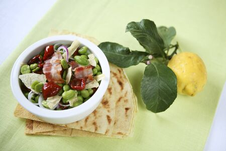 fave bean: Insalata di fave (bean salad with dried tomatoes and bacon, Italy) LANG_EVOIMAGES