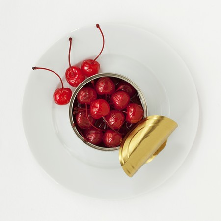 opened: An opened tin of cocktail cherries