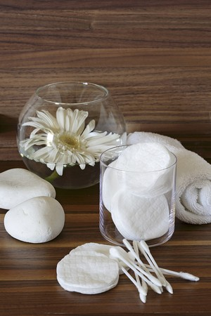 towelling: Cotton pads, cotton buds, a hand towel and a white gerbera in a glass of water LANG_EVOIMAGES