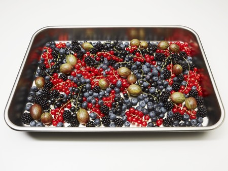 Various fresh berries on a baking tray