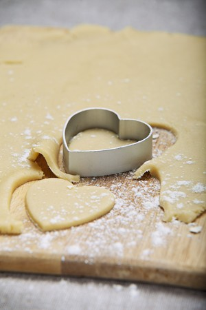 grain and cereal products: Shortbread pastry hearts being cut out LANG_EVOIMAGES