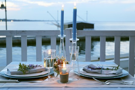 candle dinner: A table laid outside at dusk