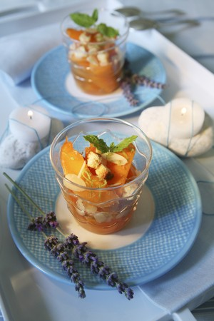 flaked: Vin Santo peaches with roasted flaked almonds, biscuit and mint leaves LANG_EVOIMAGES