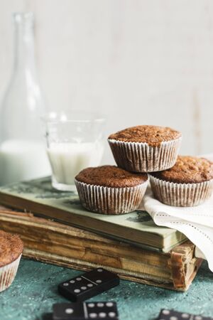 childrens food: Muffins and milk on an old book