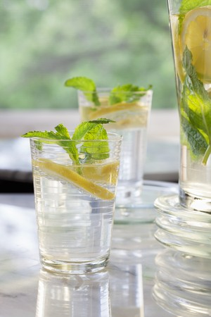 lemon water: Lemon water with mint in two glasses and a jug LANG_EVOIMAGES