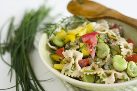 Pasta salad with broad beans, tomatoes, peppers and fresh garden herbs LANG_EVOIMAGES