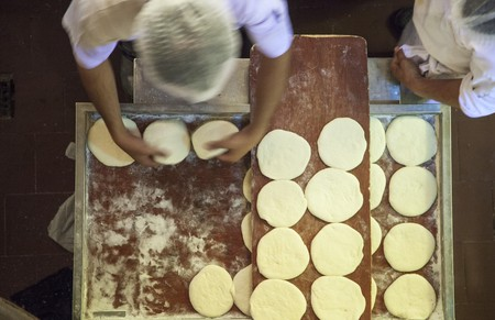 unleavened: Unleavened bread being made