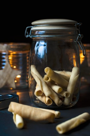 candlelit: A jar of homemade tuille biscuits for Christmas LANG_EVOIMAGES