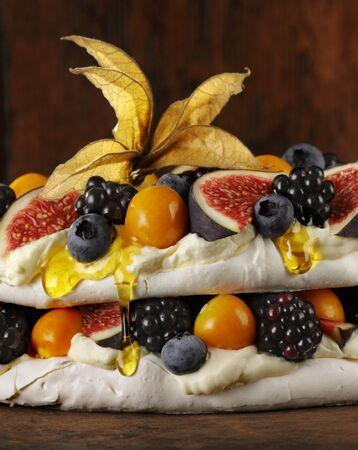 Pavlova with fruit, berries and honey