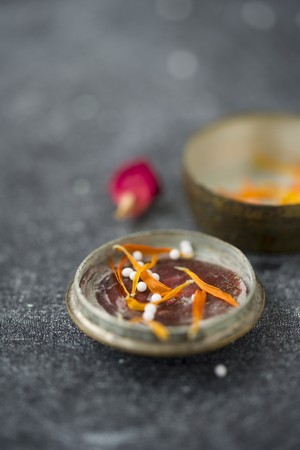 homoeopathic: Globules in the lid of an old pill tin with dried marigold petals and a dried rose petal