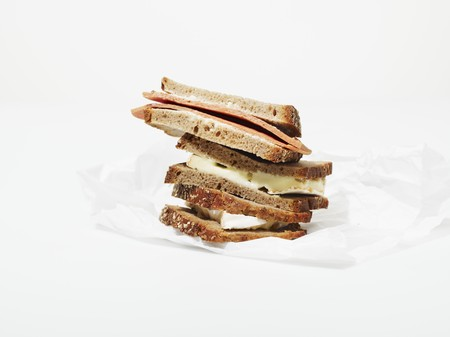 several breads: A stack of various sandwiches on a piece of greaseproof paper LANG_EVOIMAGES