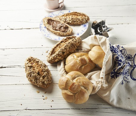 several breads: White bread rolls and muesli rolls LANG_EVOIMAGES