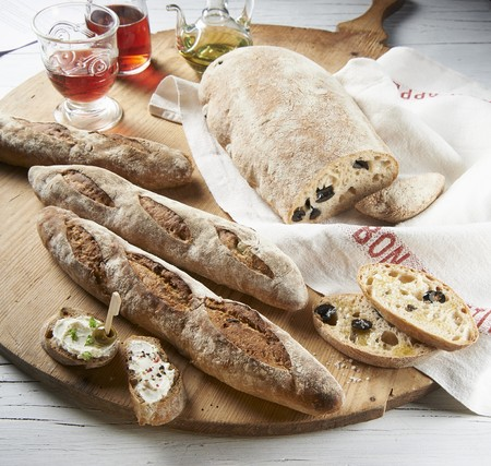 several breads: Rustic baguettes and olive bread