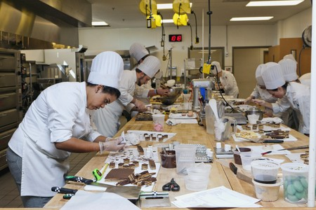 four year olds: Petit fours being made in a cookery lesson LANG_EVOIMAGES