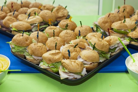 caterers: Turkey sandwiches with iceberg lettuce on trays