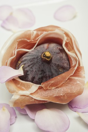 parma ham: A fig wrapped in Parma ham