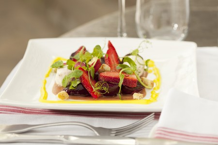 fragaria: A small beetroot salad with chilli cream cheese, strawberries, pink pepper sauce and Parmesan croutons