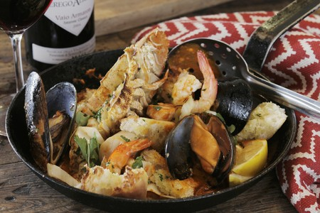 coquille: Fishermans stew with saffron white wine, cream and fresh fish. Langoustines, bugs, mussels, prawns, scallops, dorado and jewfish. Can be substituted for any fresh fish.