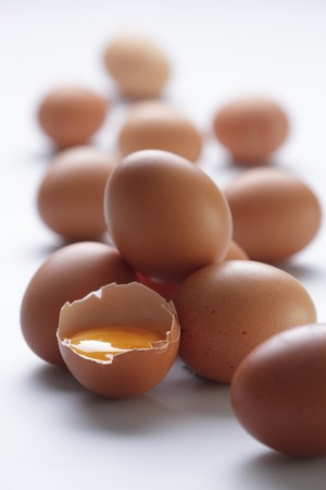 brownness: Brown eggs, one cracked open LANG_EVOIMAGES