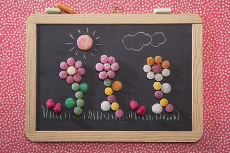 slaty: Bonbon flowers on a chalkboard LANG_EVOIMAGES