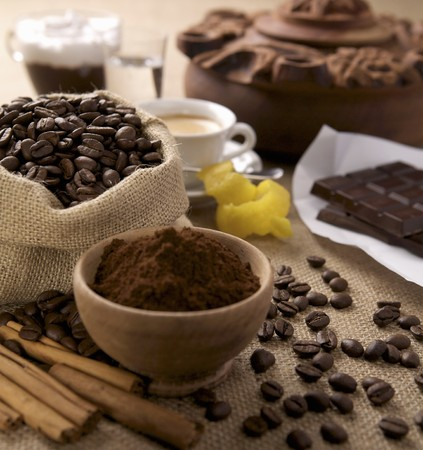 coffeebeans: An arrangement of ground coffee, coffeebeans and chocolate