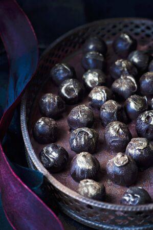chocolate truffle: Homemade dark chocolate truffle sprinkled with edible gold powder