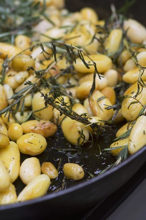 side order: Rosemary potatoes in a pan (detail)