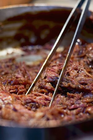 sautee: Pulled pork being fried LANG_EVOIMAGES