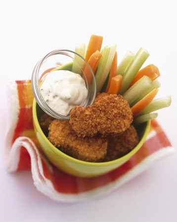 apium graveolens: Chicken nuggets with vegetable sticks and a mayonnaise dip