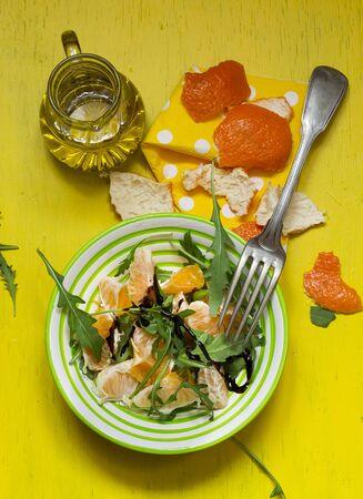 arugola: Rocket salad with mandarins, olive oil and balsamic cream