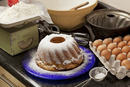 grain and cereal products: Marble cake with icing sugar and baking ingredients