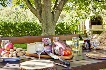 sumptuous: A sumptuous supper platter, a basket of bread, fruit and nuts on a garden table